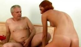 Hot red haired babe is on her knees and her pussy is poked really deep